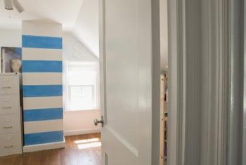 Organize a small room by choosing vertical storage units rather than horizontal.