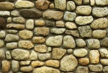 Stacked stone walls rely primarily on gravity to stay in place.
