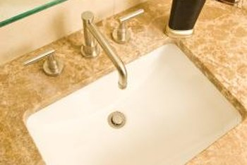 granite tops can be cut to accommodate sinks of any shape and size - Install Bathroom Sink