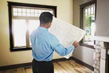 Appraisers inspect the interior of a home and its surrounding property.