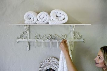 Hang bathroom towels on display racks.