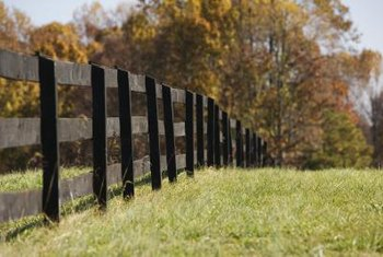 Rustic fences are made with natural materials that often blend in with the surroundings.
