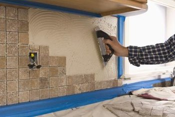 Mortar is designed to permanently adhere tile to a cement backer board.