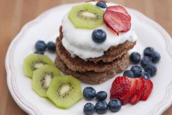 Fruit adds carbs to oatmeal pancakes, but also increases the fiber and nutrient content.