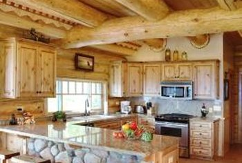 Choose cabinets that blend instead of contrast with the log walls.