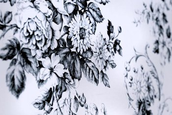 Repeating floral prints are common images on toile fabric.