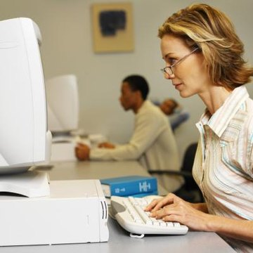 Side profile of a woman working at a computer