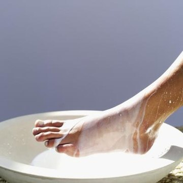Anointing a guest with oil was common during Jesus' time, but washing a guest's feet was a sign of submission.