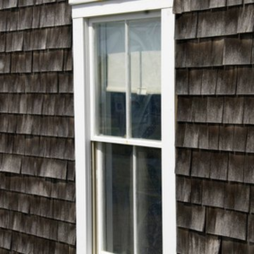 Putting wood shingles on a home is a way to make the exterior coastal themed.