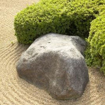 Raked granite, irregular rocks and shaped plants create a meditation garden.