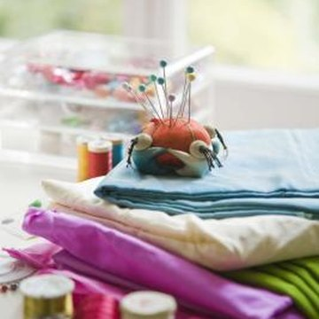 Cut large pieces of fabric, sheets or T-shirts into yarn for rag rugs.
