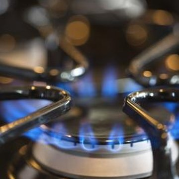 Daily cleaning prevents burned-on food on gas stove ranges.