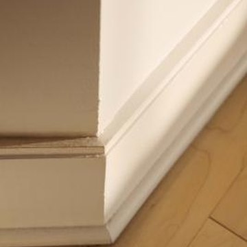 Install base trim in a house for a finished look.