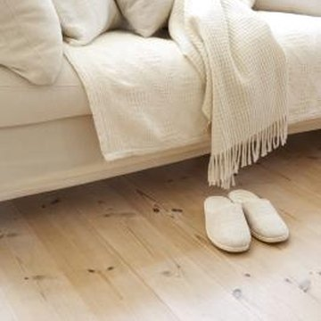 A rug or homemade rubber foot pads for the couch prevent sliding.