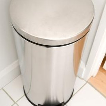You can hide a kitchen trash can behind other elements in the kitchen or decorate it to conceal it in plain sight.
