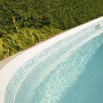 Proper landscaping enhances the look of your above-ground pool.