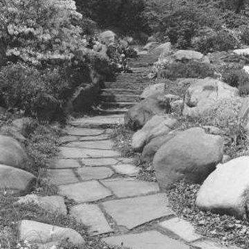 How to build a raised garden with garden stones home for Garden soil layers