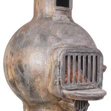 Remove the rust before painting a rusty wood stove.
