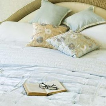 Upholstered headboards make comfortable backrests for reading in bed.