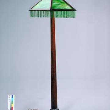Loose or wobbly floor lamps can be tightened by hand or with tools.