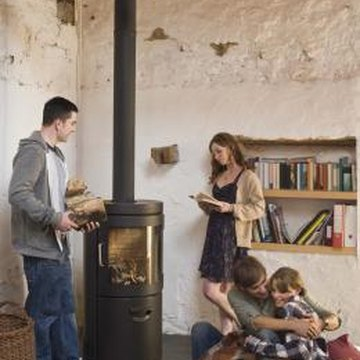 Freestanding stoves create a cozy family gathering space.