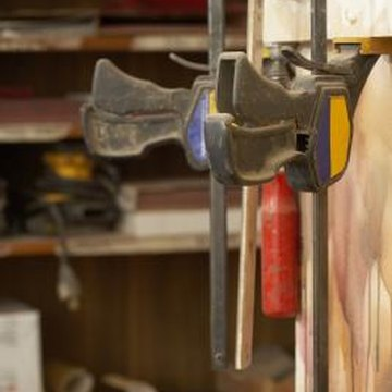 Use clamps and glue to fix splintered veneer.