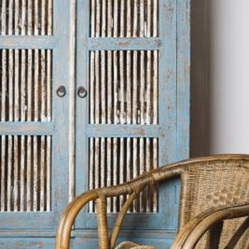 Converting an armoire into a dry bar makes matching existing décor easy.