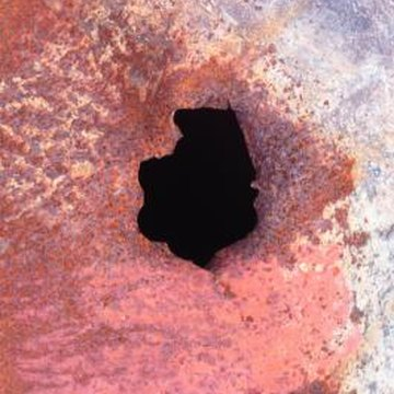 Rust will eventually cause holes in metal.