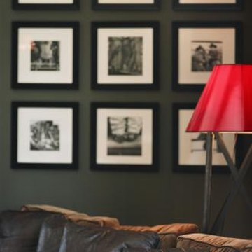 Groups of wall art should have equal spacing that is narrower than the frame's width.