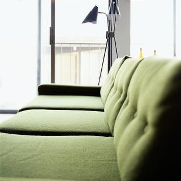The colors that you surround your sofa with can help it blend or stand out in the room.