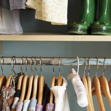 Some shelf brackets have openings for a hanging bar, which increases storage possibilities.