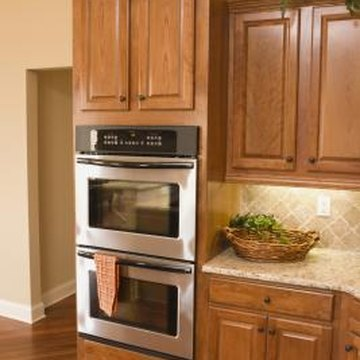 Gold or peach granite countertops coordinate in kitchens with Honey Spice cabinetry.