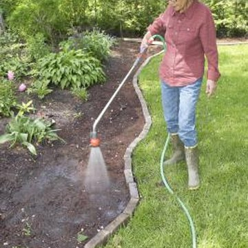 Moisture is lost to evaporation when you use a hose to water your garden.