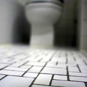 A paper template can help you tile around the toilet.