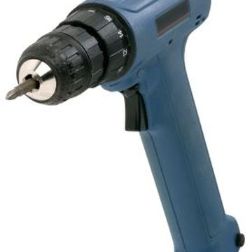 A cordless drill with a screw tip saves time when working on doors.