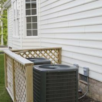 Pipes carry the coolant gas from the condenser outside to the evaporator inside the house.