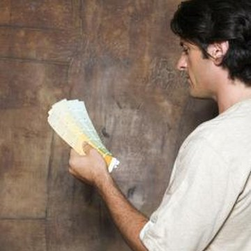 Applying multiple coats of primer to a sponge-painted wall is necessary if your new paint is a lighter shade.