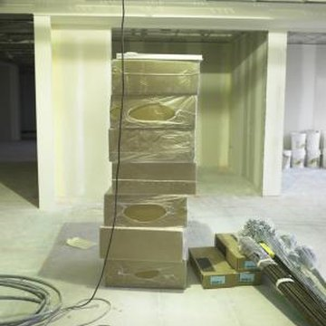 Build and attach walls to a suspended ceiling before installing the ceiling tiles.