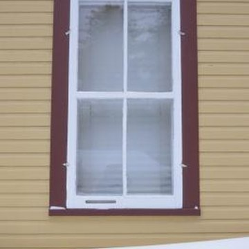 Aluminum siding will need to be removed to replace any windows.