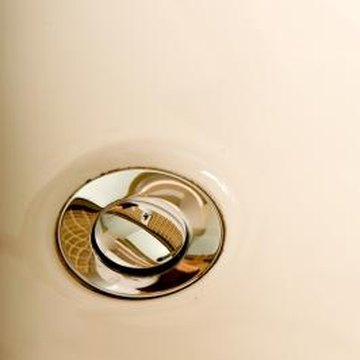 The flange and top of the stopper are visible in the sink.