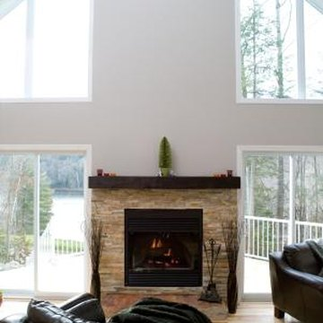 A stone facade warms up the lower part of this modern two story fireplace.