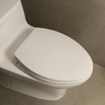 An upstairs toilet installs on the toilet flange at the floor.