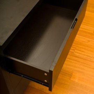 Replace slides to fix stubborn drawers.