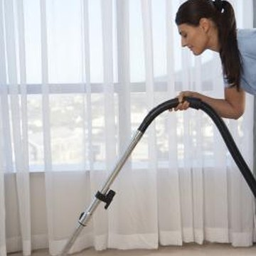 Vacuum sheer panels regularly to keep them clean.