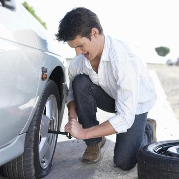 Man changing flat tire