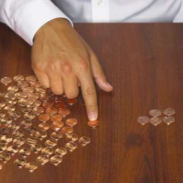 Man sorting through pennies