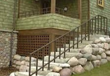 How to Drill & Install Wrought Iron Railing Into Concrete Steps