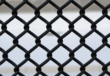 How to Attach a Chain-Link Fence to a House