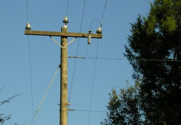 How to Remove Telephone Poles From Private Property