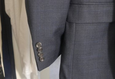Why Do Men's Suits Have Buttons on the Sleeves?